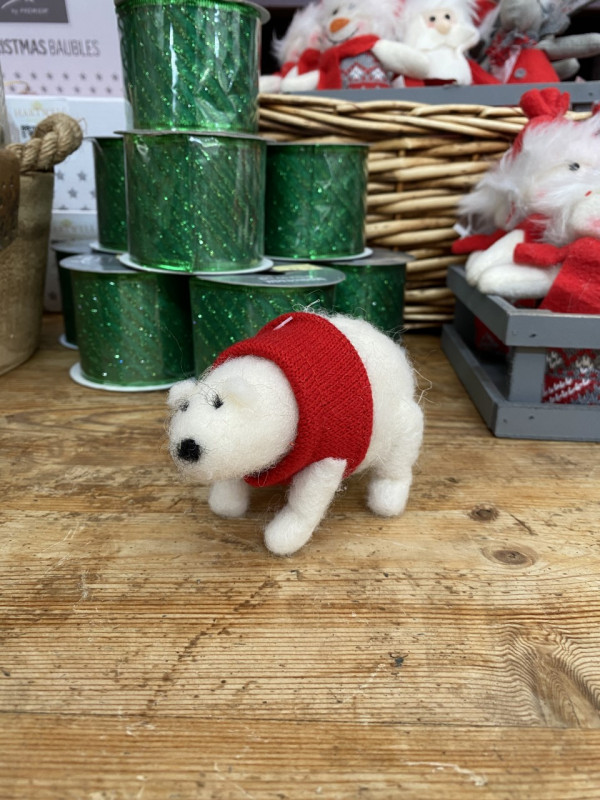 Christmas Polar bear with knitted red jumper